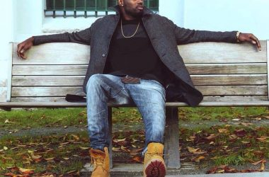 a music producer sitting on a park bench
