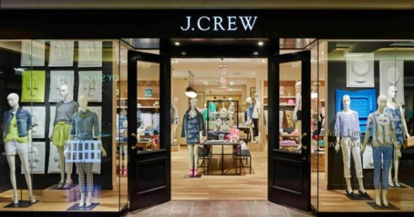 J. Crew sign and front entrance with clothed statues