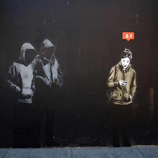 street art of girl being followed by 2 hooded men by iheart