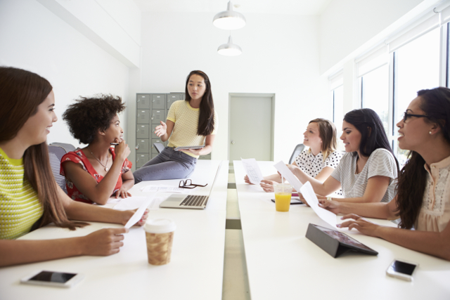 Group Of Women Working Together In Design Studio by Blog Connections NY
