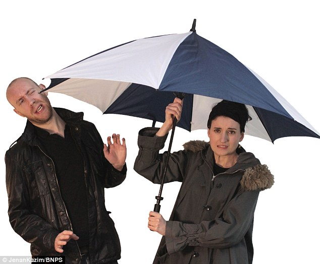 guy getting poked in the face with an umbrella