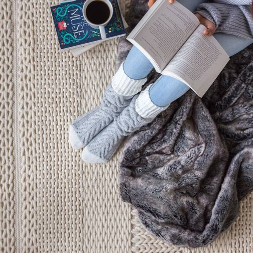 cozy socks, book, blanket, and coffee