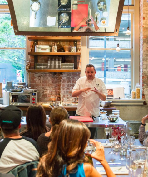 instructor at Dirty Apron teaching cooking class