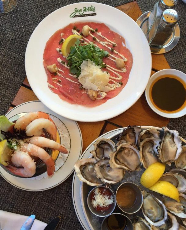 Happy hour oysters, prawns, and seafood at Joe Fortes