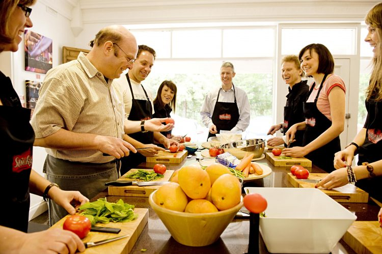 adults taking a cooking class