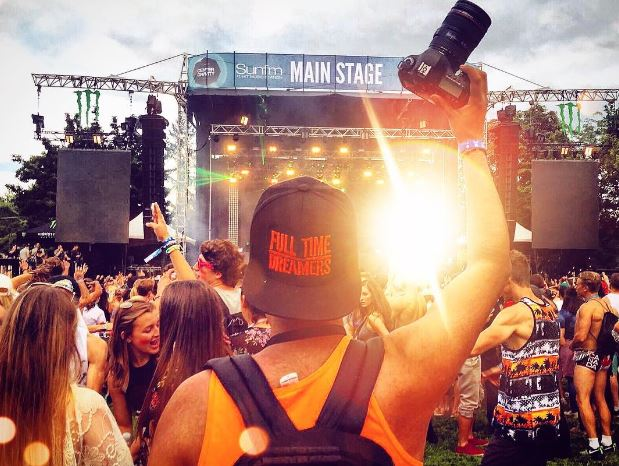 guy taking a photo at a music festival