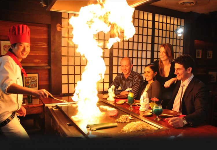 teppanyaki chef cooking with flame