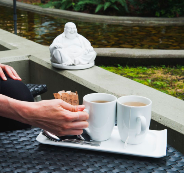 coffee with buddha in the courtyard at Loden Hotel