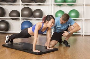 woman doing exercise with a personal trainer
